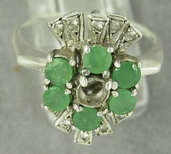 Silver ring missing an emerald
